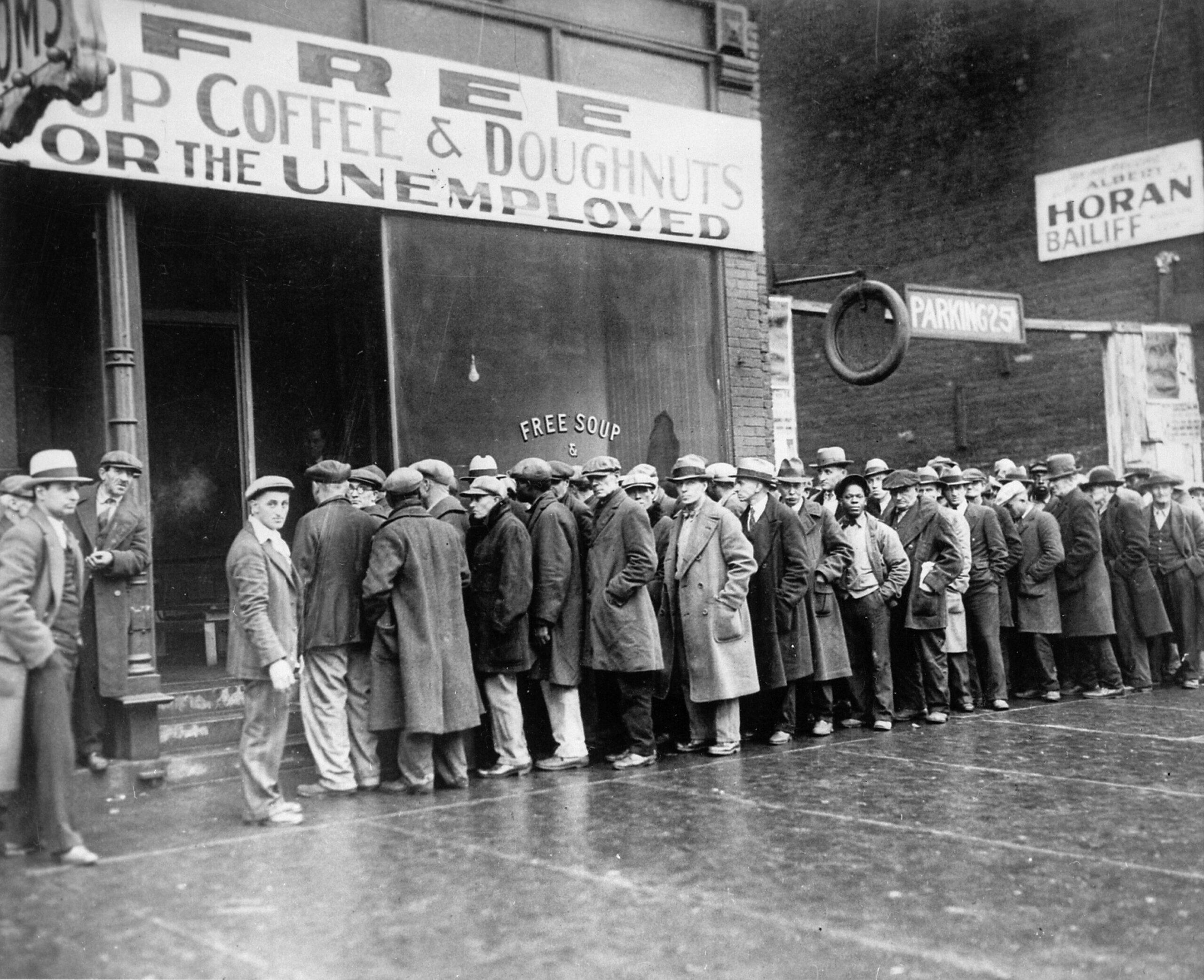 CLUB GIGGLE Unemployed_men_queued_outside_a_depression_soup_kitchen_opened_in_Chicago_by_Al_Capone_02-1931_-_NARA_-_541927-scaled 27 Haunting Photos Of  America  During The Great Depression