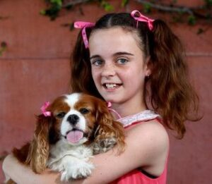 CLUB GIGGLE girl-in-pigtails-w-ribbon-300x261 Pets Who Are Identical To Their Owners
